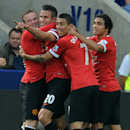 Manchester United's Robin van Persie, second left, celebrates after scoring against Leicester with Wayne Rooney, left, Angel Di Maria, 2nd right, and Rafael, during the English Premier League soccer match between Leicester City and Manchester United at Ki