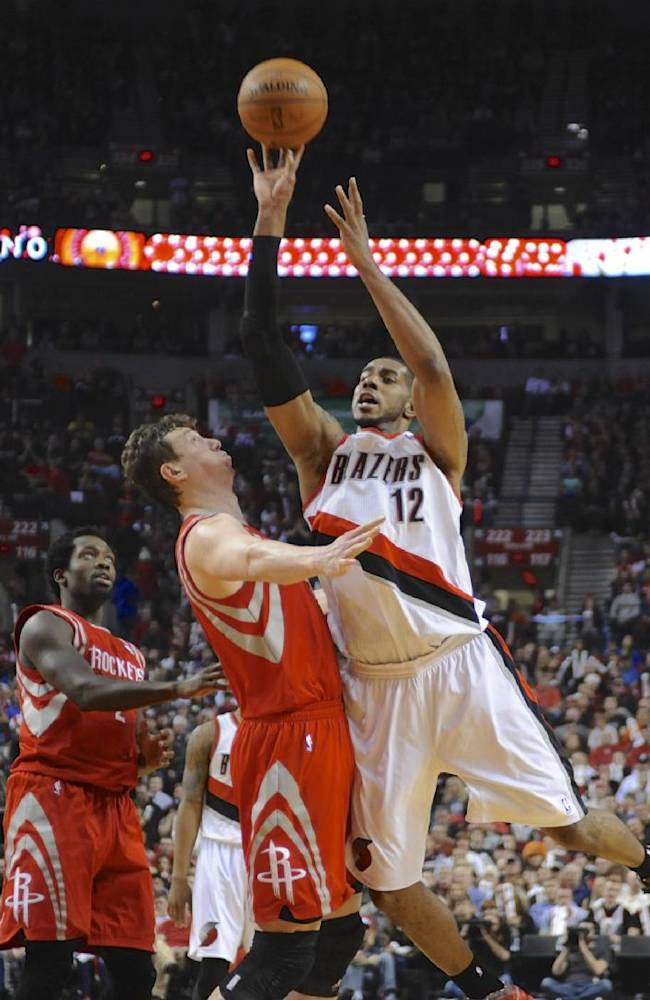 Portland Trail Blazers' LaMarcus Aldridge (12) shoots against Houston Rockets' Omer Asik (3) during the second half of game four of an NBA basketball first-round playoff series game in Portland, Ore., Sunday April 27, 2014. The Trail Blazers beat the Rockets 123-120 in overtime