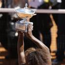 Serena Williams of the United States holds the trophy after defeating Belarus' Victoria Azarenka during their final match at the Italian Open tennis tournament in Rome, Sunday, May 19, 2013. Williams won 6-1, 6-3. (AP Photo/Alessandra Tarantino)