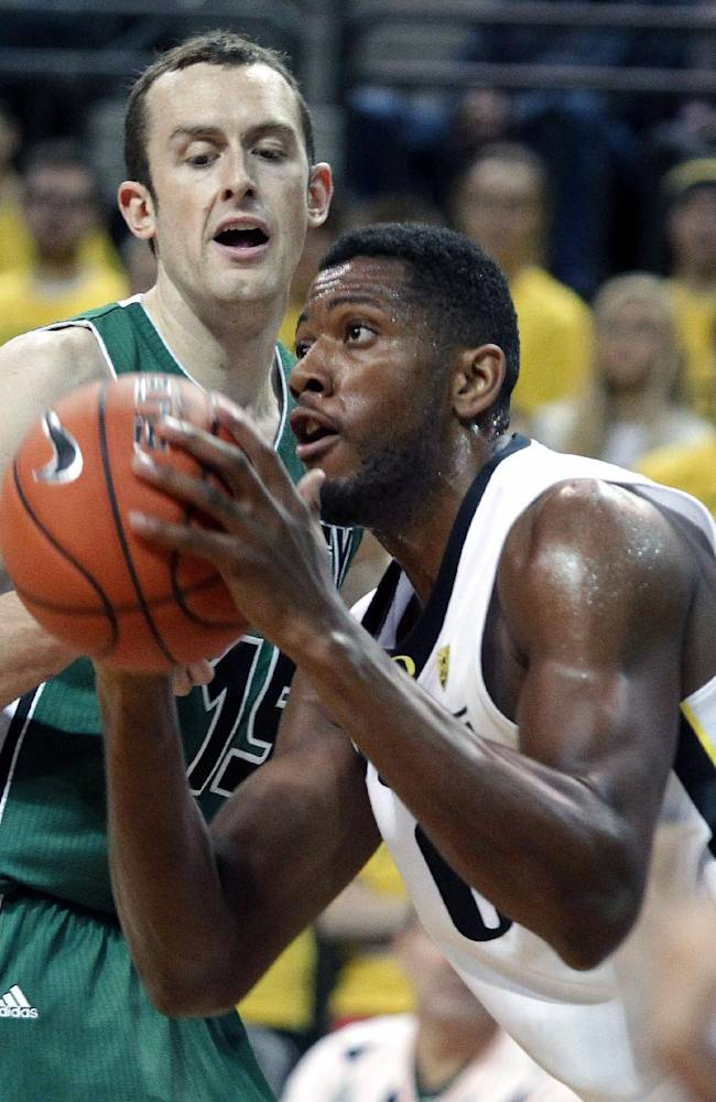 Oregon forward Mike Moser, right, looks to the basket as Utah Valley forward Mitch Bruneel defends during the first half of an NCAA college basketball game in Eugene, Ore., Tuesday, Nov. 19, 2013