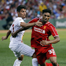 Liverpool FC forward Jordon Ibe (33) vies for the ball against AS Roma's Michele Somma, left, during a friendly soccer match at Fenway Park in Boston, Wednesday, July 23, 2014. (AP Photo)