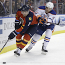 Florida Panthers defenseman Dmitry Kulikov (7) and Edmonton Oilers left wing Taylor Hall (4) go for the puck in the first period of an NHL hockey game, Saturday, Jan. 17, 2015, in Sunrise, Fla The Associated Press