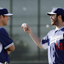 Los Angeles Dodgers' Dan Haren, right, shows Clayton Kershaw a grip during spring training baseball practice Sunday, Feb. 9, 2014, in Glendale, Ariz The Associated Press
