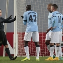 Manchester City players remonstrate with referee Istvan Vad after he awarded a penalty to CSKA during the Champions League Group E soccer match between CSKA Moscow and Manchester City at Arena Khimki stadium in Moscow, Russia, Tuesday Oct. 21, 2014
