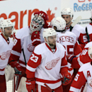 Detroit Red Wings goaltender Jonas Gustavsson (50) celebrates with teammates after beating the Ottawa Senators 6-1 during NHL hockey action in Ottawa, Thursday, Feb. 27, 2014 The Associated Press