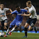 Chelsea's Samuel Eto'o, center, competes with Tottenham Hotspur's Michael Dawson, right, during their English Premier League soccer match at Stamford Bridge, London, Saturday, March 8, 2014