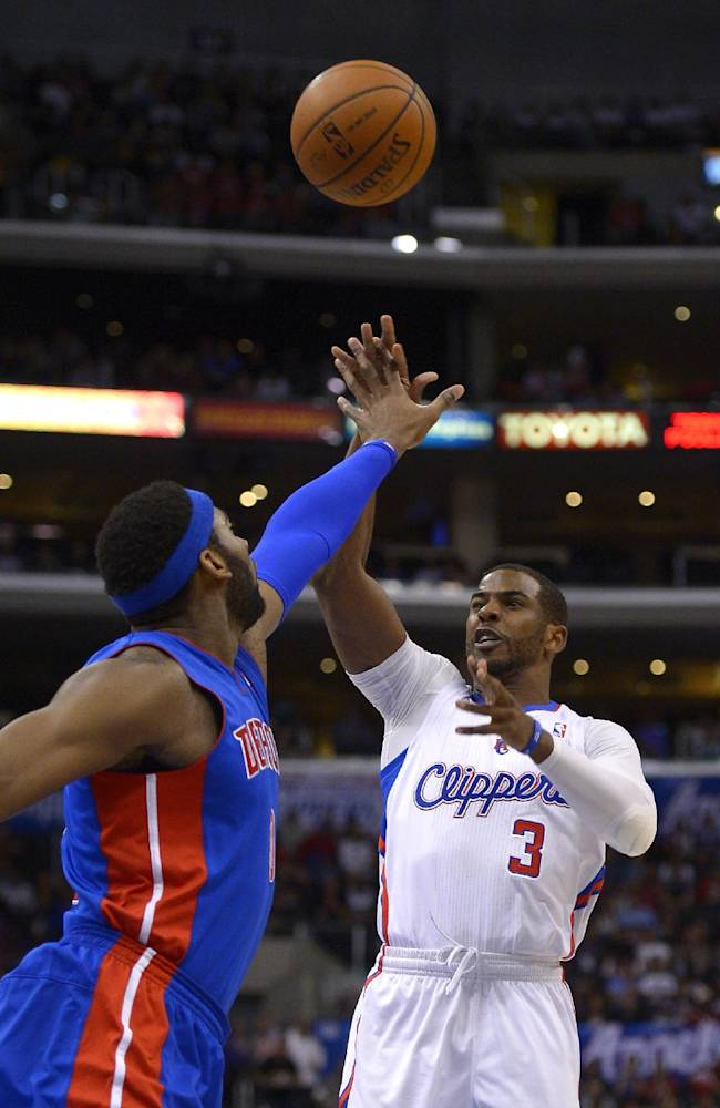 Los Angeles Clippers guard Chris Paul, right, shoots as Detroit Pistons center Andre Drummond defends during the first half of an NBA basketball game, Saturday, March 22, 2014, in Los Angeles