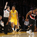 Los Angeles Lakers forward Nick Young reacts after making a 3-pointer next to Portland Trail Blazers guard Wesley Matthews, right, during the first half of an NBA basketball game in Los Angeles, Tuesday, April 1, 2014 The Associated Press