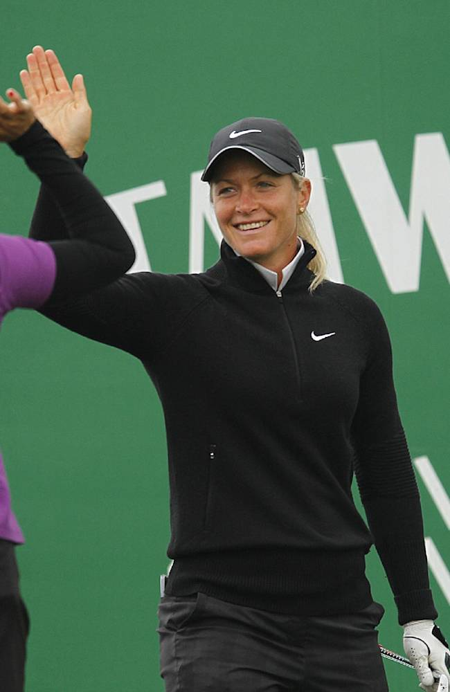 Suzann Pettersen of Norway, right, is cheered by Irene Cho of the United States after Pettersen's hole in one on the 2nd hole during the second round of the Sunrise LPGA Taiwan Championship tournament at the Sunrise Golf & Country Club, Friday, Oct. 25, 2013, in Yangmei, north eastern Taiwan
