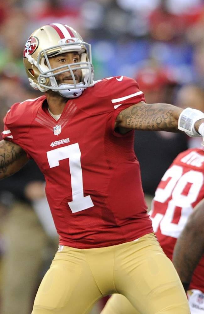 San Francisco 49ers quarterback Colin Kaepernick (7) throws to a receiver as he is pressured in the first half of an NFL preseason football game against the Baltimore Ravens, Thursday, Aug. 7, 2014, in Baltimore