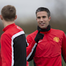 Manchester United's Robin van Persie, right, trains with teammates at Carrington training ground in Manchester, Monday, Feb. 24, 2014. Manchester United will play Olympiakos in a Champions League first knockout round on Tuesday