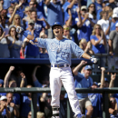 Kansas City Royals' Norichika Aoki celebrates after hitting a two-run triple during the fourth inning of a baseball game against the Detroit Tigers, Sunday, Sept. 21, 2014, in Kansas City, Mo. (AP Photo/Charlie Riedel)