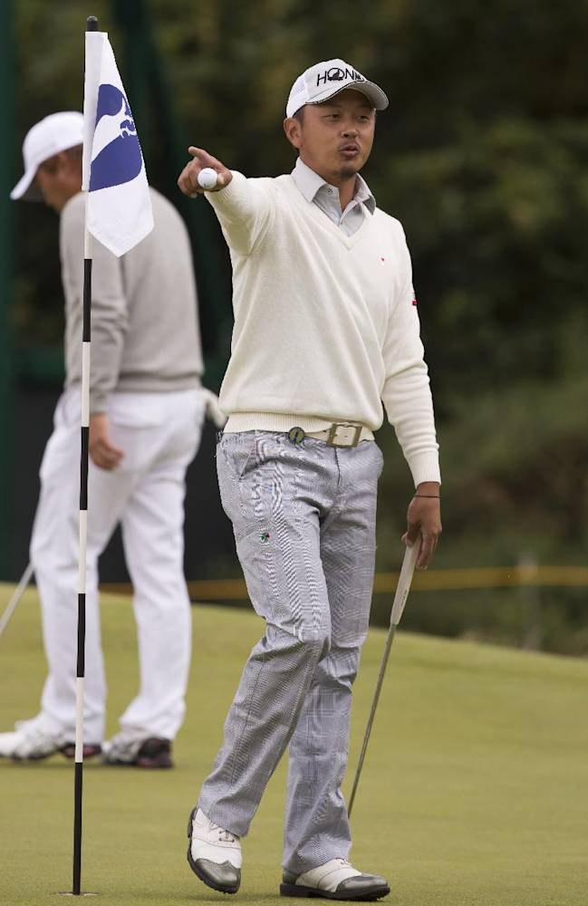 Hiroshi Iwata of Japan gestures as he stands on the 4th green during a practice round at Royal Liverpool Golf Club prior to the start of the British Open Golf Championship, in Hoylake, England, Monday, July 14, 2014. The 2014 Open Championship starts on Thursday, July 17