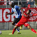 Duesseldorf's Sergio da Silva Pinto, right, and Emmerson Boyce of Wigan Athletic challenge for the ball during a preseason test match between German second divisioner Fortuna Duesseldorf and Wigan Athletic of England in Duesseldorf, Germany, Saturday