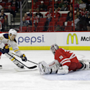 Carolina Hurricanes' Andrej Sekera (4), of Slovakia, and goalie Cam Ward (30) defend as Buffalo Sabres' Marcus Foligno (82) scores during the first period of an NHL hockey game in Raleigh, N.C., Tuesday, Oct. 14, 2014 The Associated Press