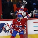 Washington Capitals right wing Tom Wilson (43) is upended by Montreal Canadiens center Tomas Plekanec (14) during the second period of an NHL hockey game Saturday, Jan. 31, 2015, in Montreal The Associated Press