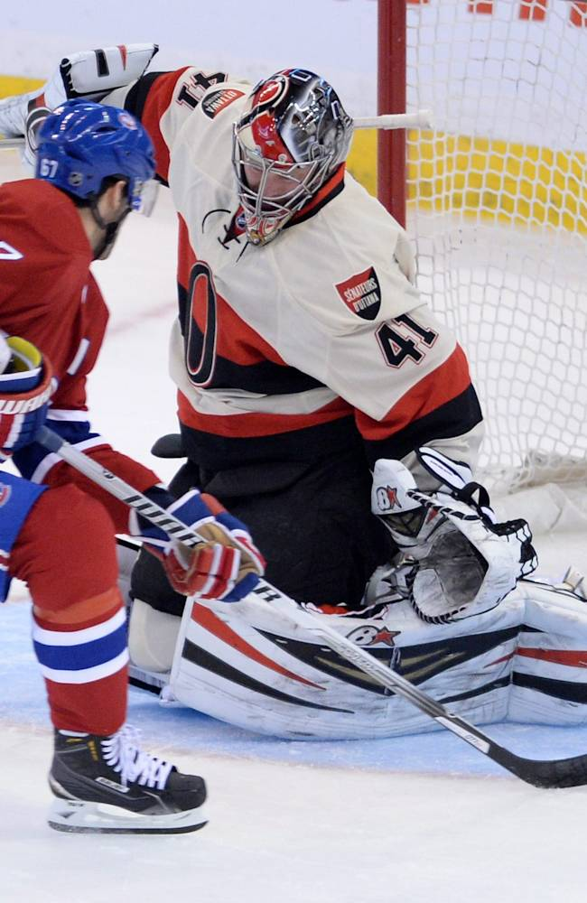 Montreal Canadiens forward Max Pacioretty puts the puck past Ottawa Senators goalie Craig Anderson during first period NHL hockey action in Ottawa on Friday, April 3, 2014