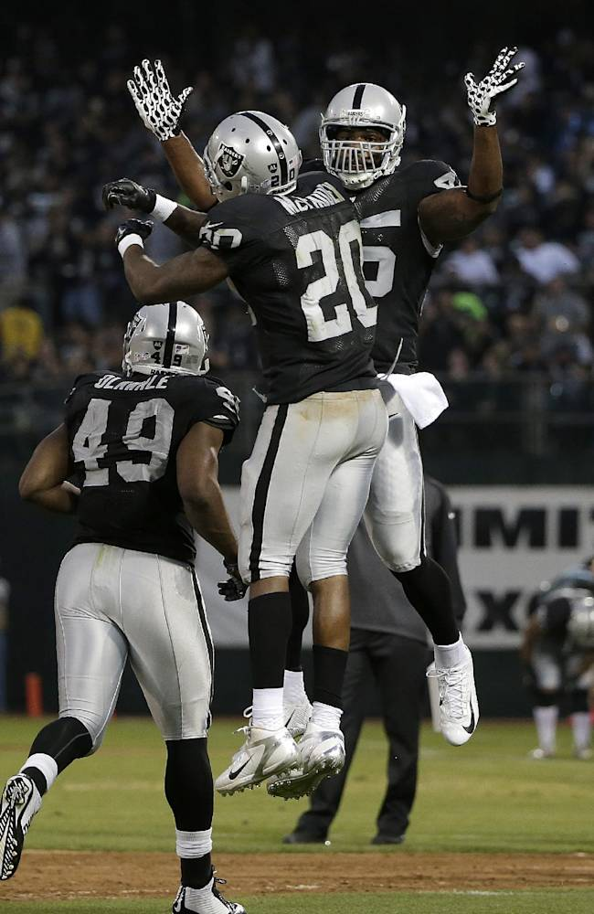Oakland Raiders running back Darren McFadden (20) celebrates after scoring on a 1-yard touchdown run with fullback Marcel Reece during the second quarter of an NFL preseason football game against the Detroit Lions in Oakland, Calif., Friday, Aug. 15, 2014