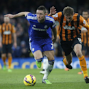 Chelsea's Gary Cahill, left, takes the ball away from Hull's Nikica Jelavic during their English Premier League soccer match between Chelsea and Hull City at Stamford Bridge stadium in London, Saturday, Dec. 13, 2014