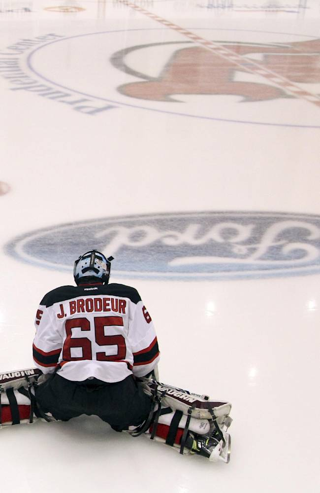 Jeremy Brodeur, son of New Jersey Devils' goalkeeper Martin Brodeur, stretches during the Devils' rookies NHL hockey camp, Tuesday, July 15, 2014, in Newark, N.J. Brodeur, along with his twin brother, William Brodeur, and their older brother, Anthony Brodeur, 19, are participating in camp