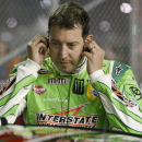 Kyle Busch puts on ear plugs before getting in his car for the start of a NASCAR Sprint Cup series auto race at Daytona International Speedway, Sunday, July 5, 2015, in Daytona Beach, Fla. (AP Photo/John Raoux)