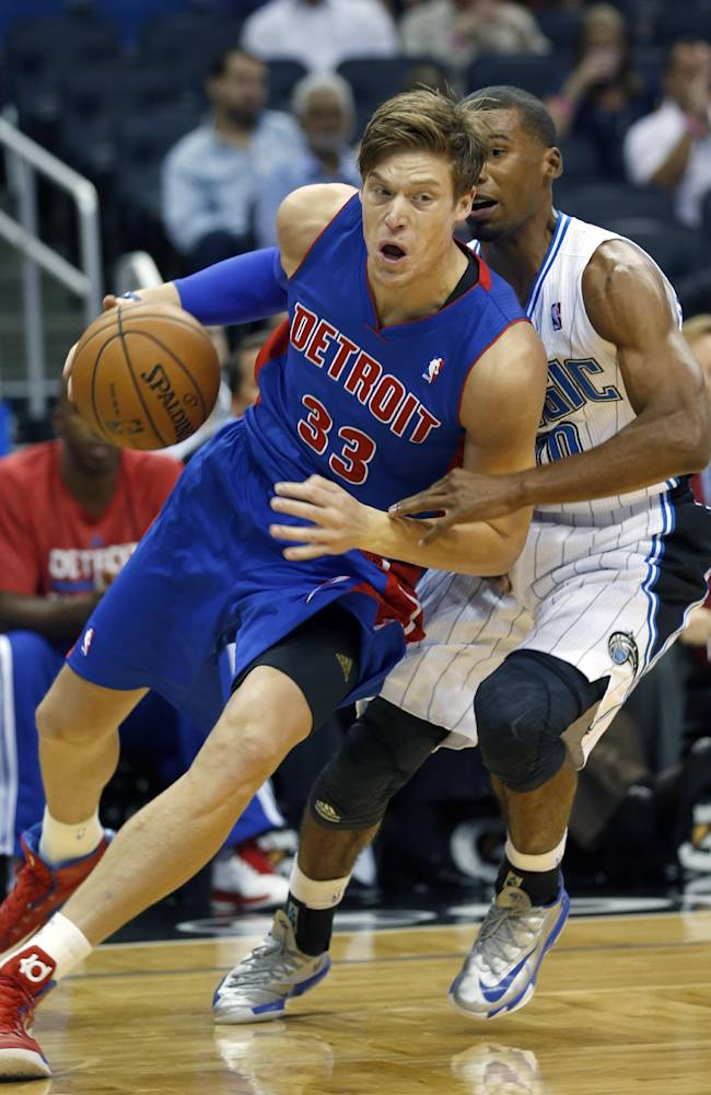 Detroit Pistons forward Jonas Jerebko (33) drives past Orlando Magic guard Ronnie Price (10) during the first half of an NBA basketball game on Sunday,  Oct.  20, 2013 in Orlando, Fla