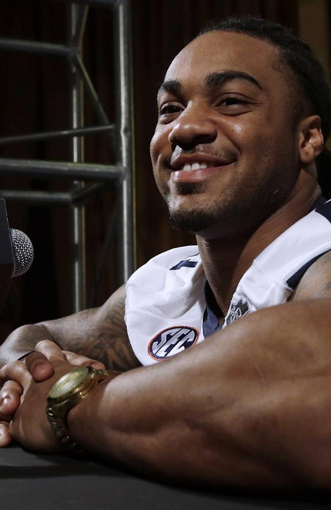 Auburn's Tre Mason answers a question during media day for the NCAA BCS National Championship college football game Saturday, Jan. 4, 2014, in Newport Beach, Calif. Florida State plays Auburn on Monday, Jan. 6, 2014