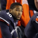 Auburn quarterback Kiehl Frazier (10) looks at the scoreboard as Texas A&M puts up another score during the second half of an NCAA college football game on Saturday, Oct. 27, 2012, in Auburn, Ala. (AP Photo/Butch Dill)