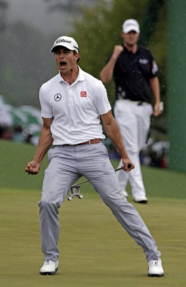 In this April 14, 2013, file photo, Adam Scott, of Australia, celebrates after a birdie putt on the 18th green during the fourth round of the Masters golf tournament, in Augusta, Ga. In rear is fellow Australian golfer Marc Leishman. Scott considers it the signature moment of his career, even if it wasn't the putt that made him the first Australian to win the Masters