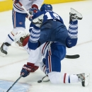 Toronto Maple Leafs' Joffrey Lupul, right, collides with Montreal Canadiens' Tom Gilbert during first period NHL hockey action in Toronto on Wednesday, Oct. 8, 2014 The Associated Press