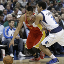 Houston Rockets point guard Jeremy Lin (7) drives against Dallas Mavericks point guard Shane Larkin (3) during the first half of an NBA basketball game in Dallas, Wednesday, Nov. 20, 2013 The Associated Press
