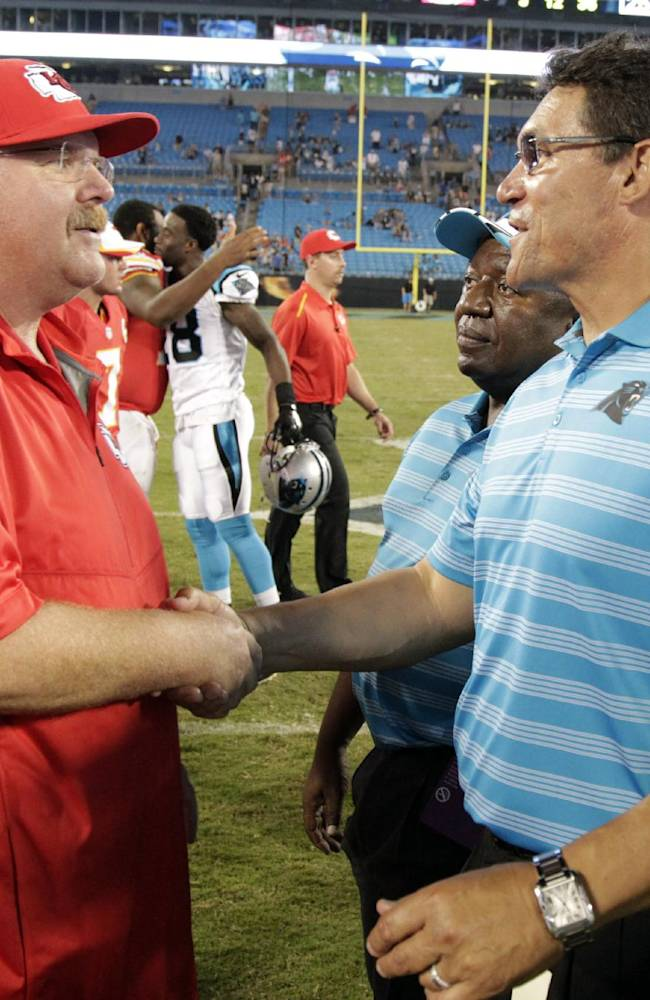 Kansas City Chiefs head coach Andy Reid, left, shakes hands with Carolina Panthers head coach Ron Rivera, right, after a preseason NFL football game in Charlotte, N.C., Sunday, Aug. 17, 2014. The Panthers won 28-16