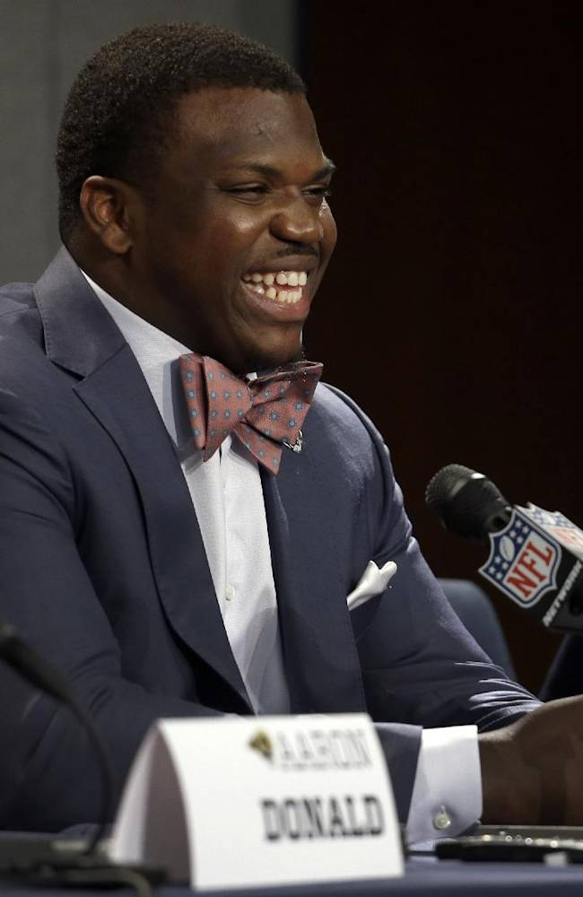 St. Louis Rams first-round draft pick Greg Robinson speaks during a news conference at the NFL football team's practice facility Tuesday, May 13, 2014, in St. Louis. Robinson, an offensive tackle from Auburn, was picked second overall by the Rams
