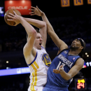 Golden State Warriors' David Lee, left, grabs a rebound next to Minnesota Timberwolves' Corey Brewer during the second half of an NBA basketball game on Monday, April 14, 2014, in Oakland, Calif. Golden State won 130-120 The Associated Press