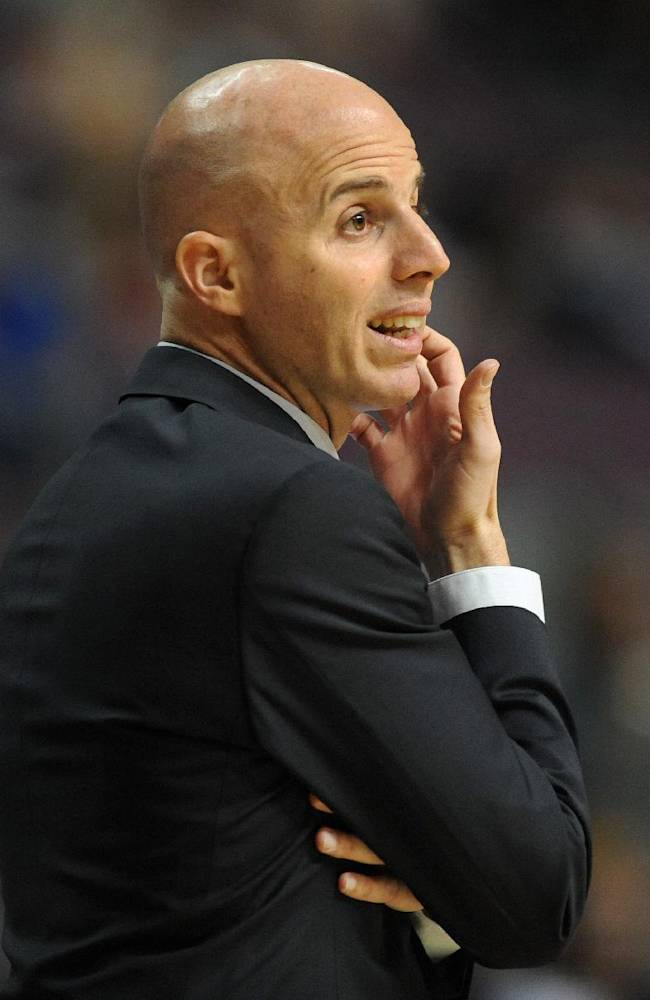 Maccabi Haifa Head Coach Danny Franco watches his team play against the Detroit Pistons during the first quarter of an NBA preseason basketball game at the Palace of Auburn Hills, Mich., Tuesday, Oct. 8, 2013