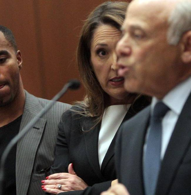Former NFL safety Darren Sharper, left, and attorney Blair Berk, center, listen as attorney Leonard Levine addresses the court in Los Angeles Superior Court on Thursday, Feb. 20, 2014, in Los Angeles. Sharper has pleaded not guilty to charges that he drugged and raped two women he met at a West Hollywood night club