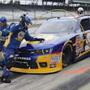 Chase Elliott makes a pit stop during the NASCAR Nationwide series auto race at Indianapolis Motor Speedway in Indianapolis, Saturday, July 26, 2014. (AP Photo/Robert Baker)