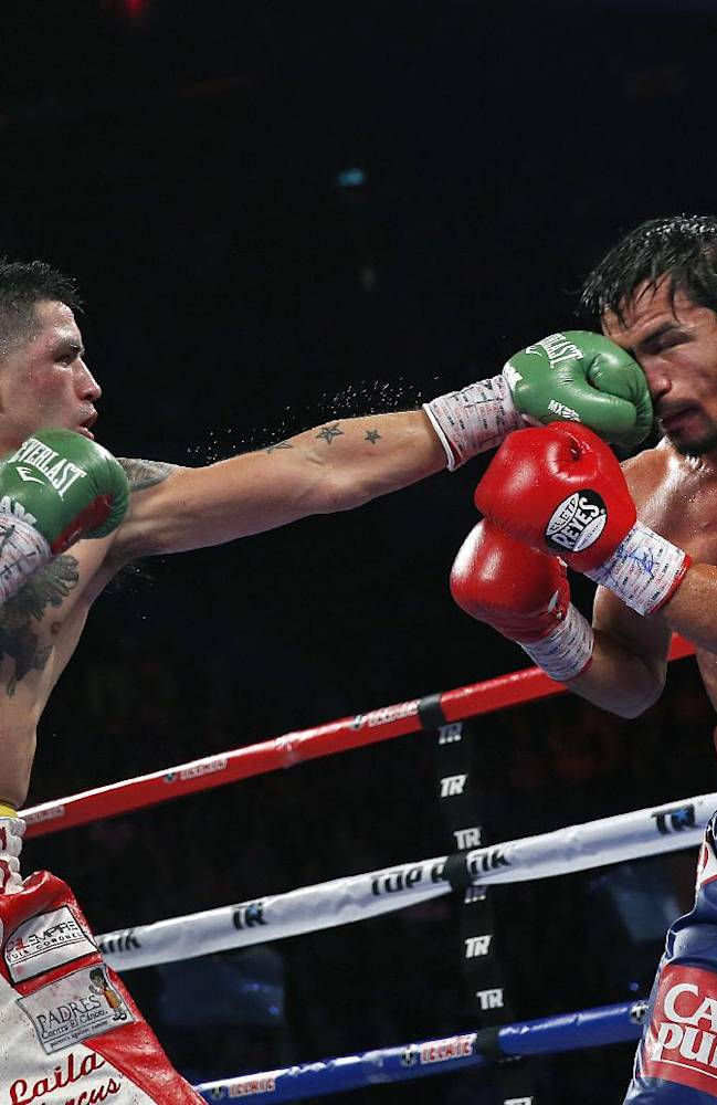 Brandon Rios of the United States, left, lands a left to Manny Pacquiao from the Philippines, during their WBO international welterweight title fight Sunday, Nov. 24, 2013, in Macau. Pacquiao defeated Rios by unanimous decision on Sunday to take the WBO international welterweight title and return to his accustomed winning ways after successive defeats
