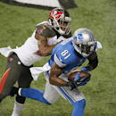 Detroit Lions wide receiver Calvin Johnson (81), defended by Tampa Bay Buccaneers cornerback Johnthan Banks (27), scores on a 6-yard reception during the first half of an NFL football game in Detroit, Sunday, Dec. 7, 2014 The Associated Press