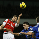 Arsenal's Olivier Giroud, second left, jumps to head the ball under pressure from Everton's Sylvain Distin, left and his teammate Gareth Barry, second right, during the English Premier League soccer match between Arsenal and Everton at the Emirates Stadiu