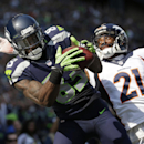 Seattle Seahawks' Ricardo Lockette (83) catches a touchdown pass in the end zone as Denver Broncos' Aqib Talib defends during the first half of an NFL football game, Sunday, Sept. 21, 2014, in Seattle The Associated Press