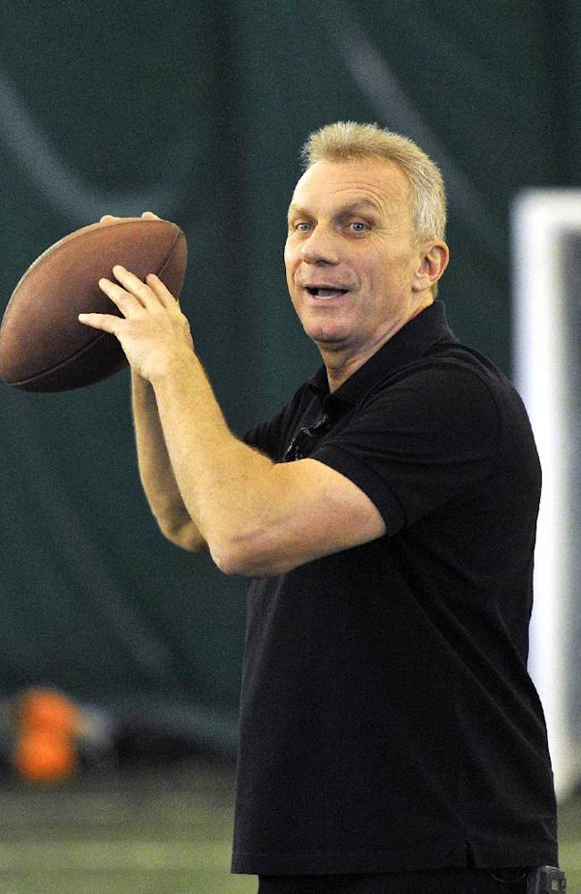 In this image taken on Thursday Oct. 24, 2013 and released by NFL, NFL legend Joe Montana gives instructions during a session with quarterbacks from British universities at Crystal Palace Sports Centre, London. The San Francisco 49ers are due to play the the Jacksonville Jaguars at Wembley stadium in London on Sunday, Oct. 27 in a regular season NFL game