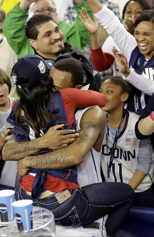 Connecticut guard Ryan Boatright celebrates with fans after his team's 60-54 victory over Kentucky in the NCAA Final Four tournament college basketball championship game Monday, April 7, 2014, in Arlington, Texas