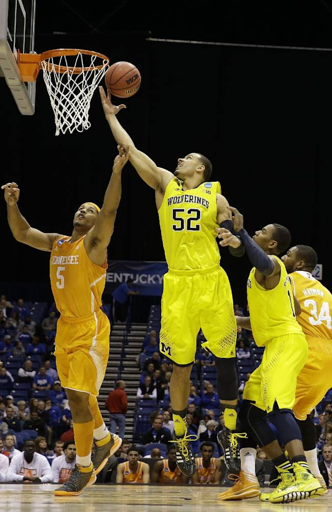 Michigan's Jordan Morgan (52) goes up for a rebound against Tennessee's Jarnell Stokes (5) during the second half of an NCAA Midwest Regional semifinal college basketball tournament game Friday, March 28, 2014, in Indianapolis