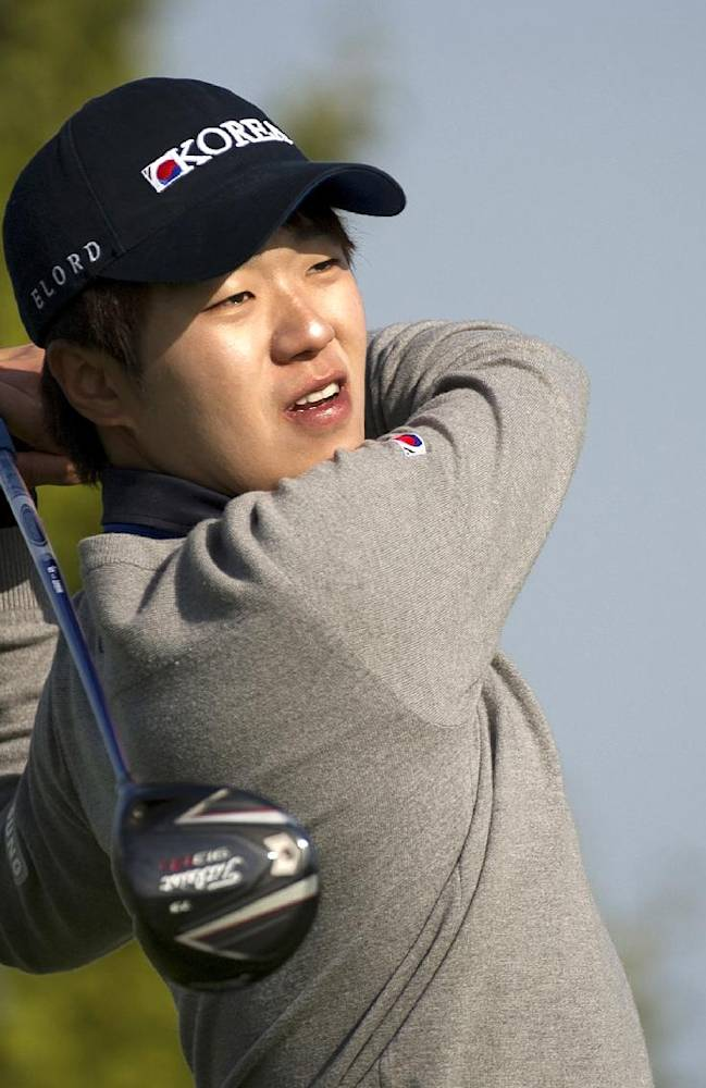 In this photo released by the the Asia-Pacific Amateur Championship,  Lee Chang-woo of South Korea watches his shot during round one of the Asia -Pacific Amateur Championship golf tournament at Nanshan International Golf Club in Longkou City, China, Thursday, Oct. 24, 2013
