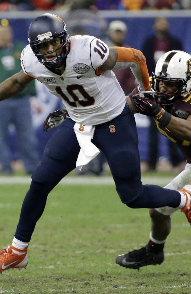 Syracuse quarterback Terrel Hunt (10) breaks away from Minnesota linebacker Aaron Hill (57) during the second half of the Texas Bowl NCAA college football game on Friday, Dec. 27, 2013, in Houston. Syracuse won 21-17