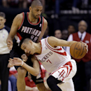 Houston Rockets' Jeremy Lin (7) tries to drive around Portland Trail Blazers' Nicolas Batum (88) during the second quarter in Game 1 of an opening-round NBA basketball playoff series Sunday, April 20, 2014, in Houston The Associated Press