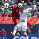 Panama's Richard Dixon, left, takes to the air to head the ball over Canada's Marcus Haber during the second half of the teams' 0-0 tie in a CONCACAF Gold Cup soccer match on Sunday, July 14, 2013, in Denver. (AP Photo/David Zalubowski)