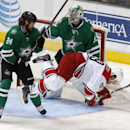 Dallas Stars goalie defenseman Jordie Benn (24) and goalie Kari Lehtonen (32) keep Carolina Hurricanes left wing Jiri Tlusty (19), of the Czech Republic, away from the goal during the first period of an NHL hockey game on Thursday, Feb. 27, 2014, in Dall