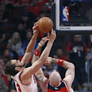 Chicago Bulls center Joakim Noah (13) battles Washington Wizards center Marcin Gortat for a rebound during the first half of Game 2 in an opening-round NBA basketball playoff series game Tuesday, April 22, 2014, in Chicago The Associated Press